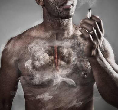 мъж с цигара и бели дробове с никотин